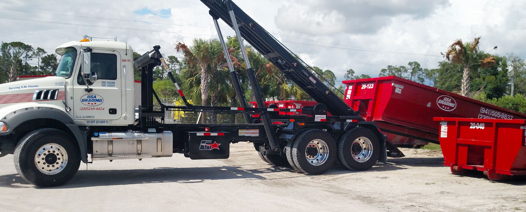 USA Grading, Inc. trucking and hauling dropping off a roll off dumpster rental in Southwest Florida